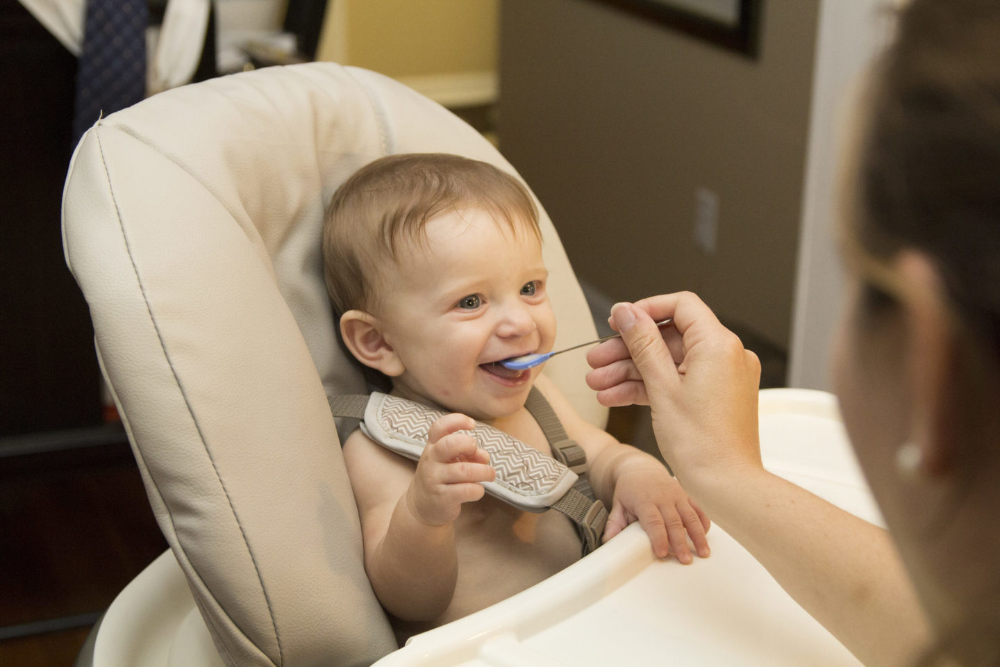 A baby being spoon-fed during weaning