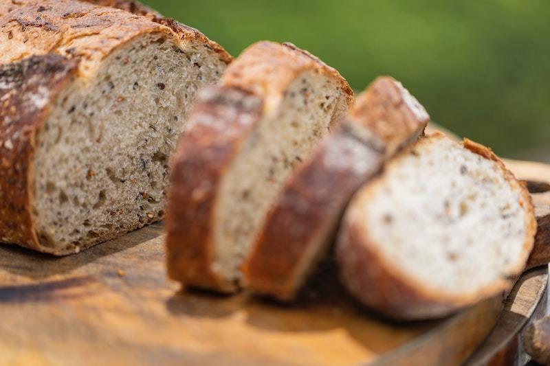 A sliced loaf of wholegrain bread