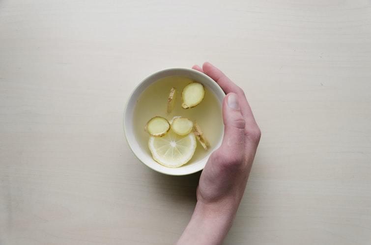 A mug of lemon and ginger tea