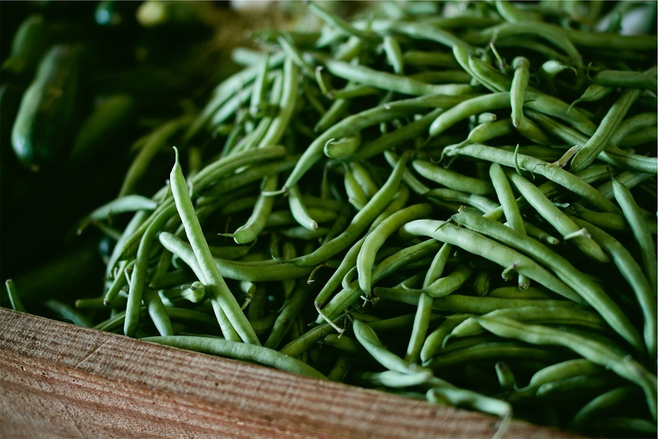 Organic string beans in a wooden crate