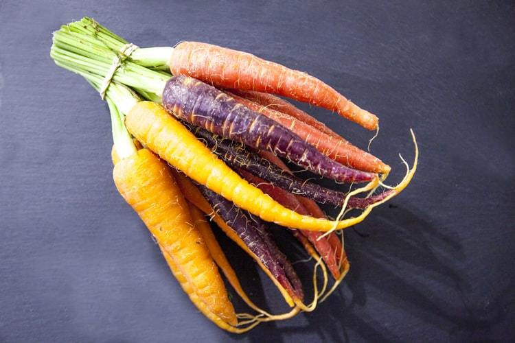 A bunch of rainbow carrots