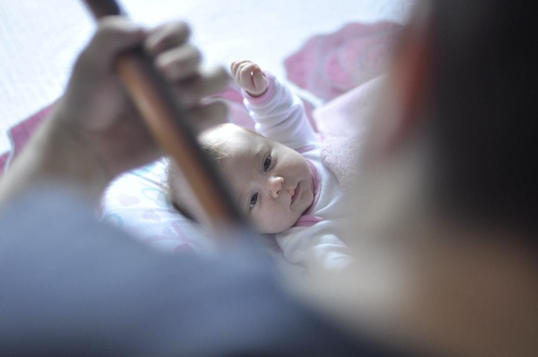 A dad playing music to a baby
