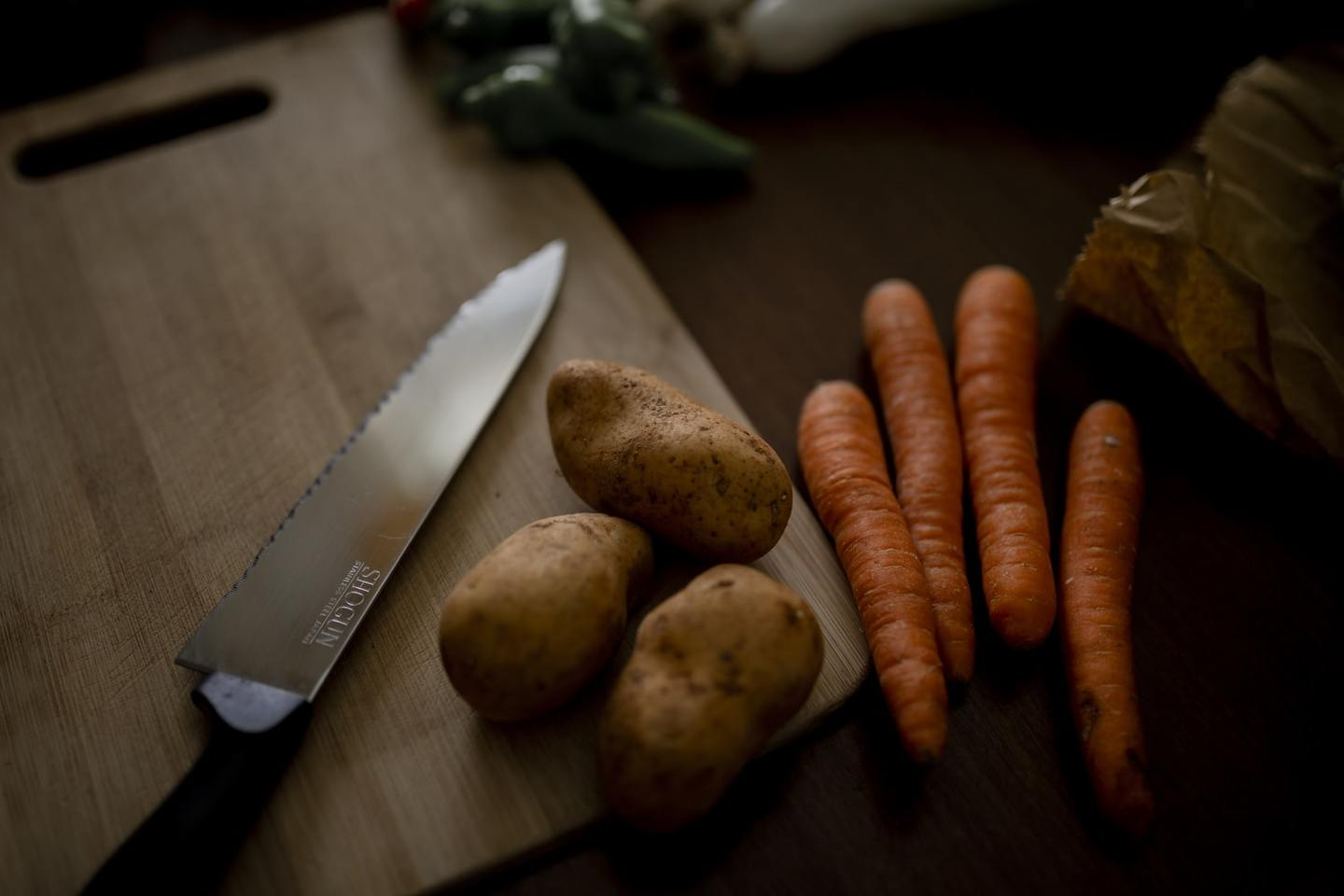 Potatoes and carrots on a chopping board