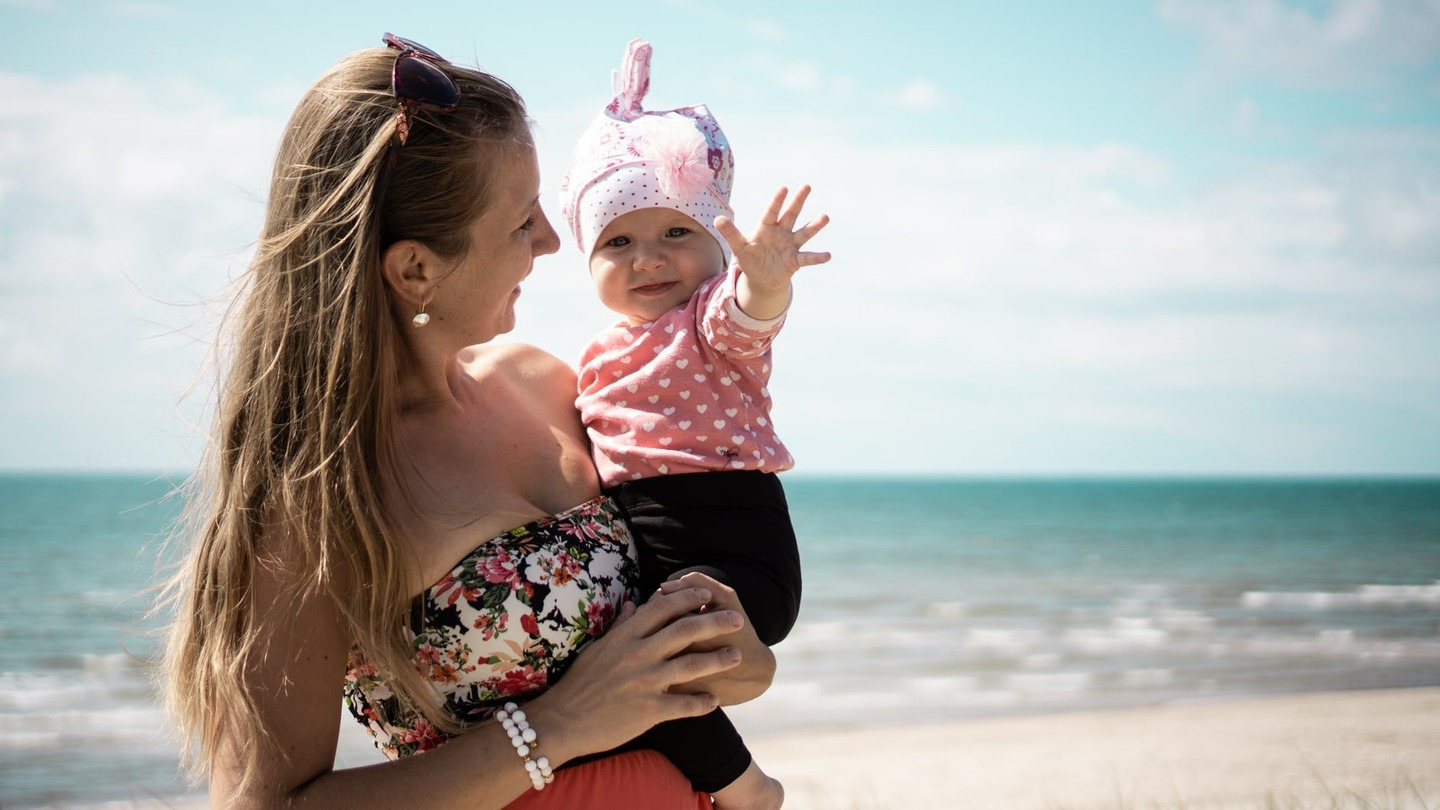 A mother and baby at the beach