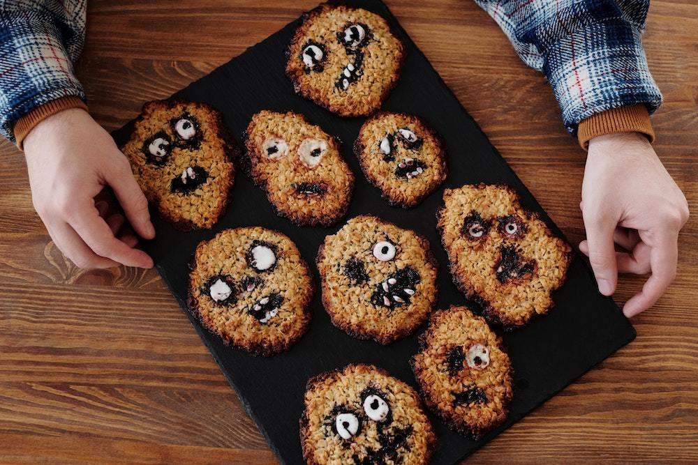 Oat cookies decorated with spooky faces