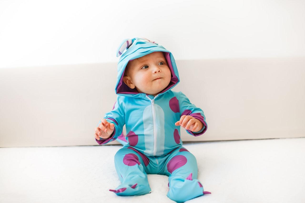baby in a monster onesie