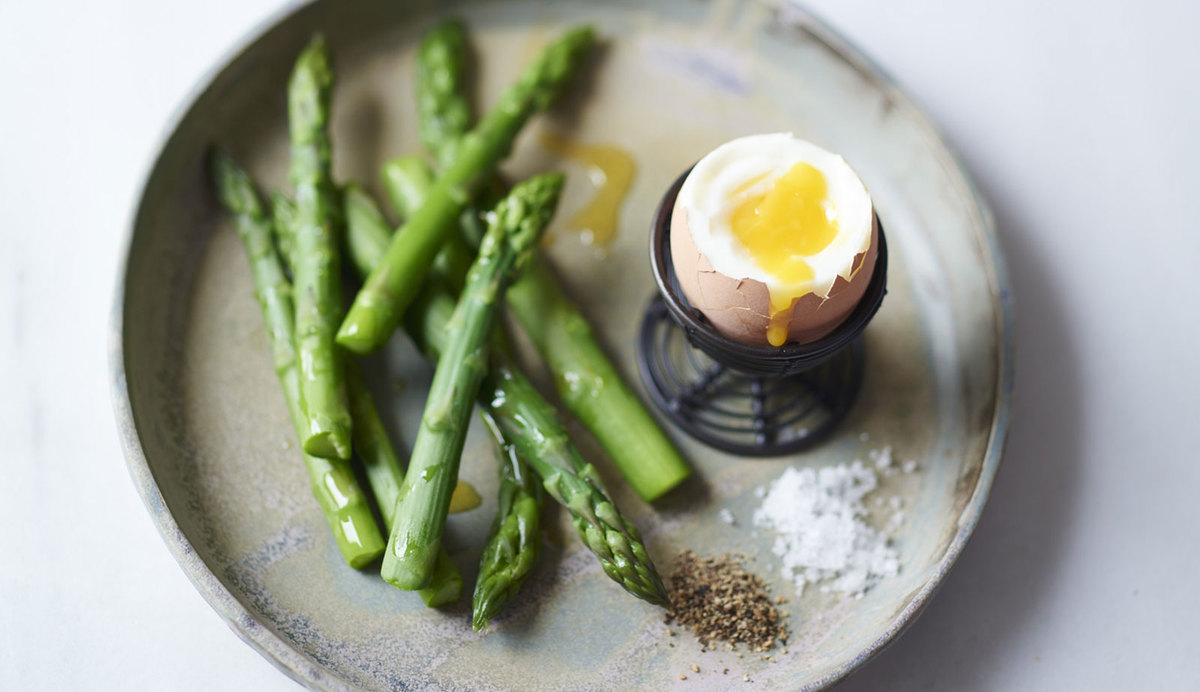Boiled egg and greens on a plate
