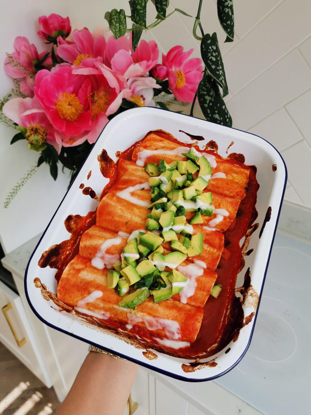 Madeleine's Family Friendly Squash & Black Bean Enchilada's in a ceramic bowl