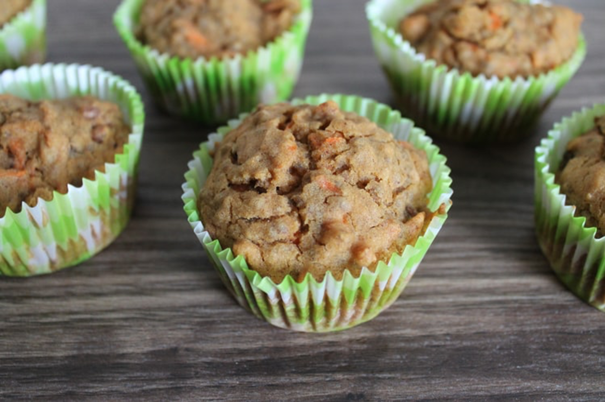 Pumpkin and carrot muffins on a table
