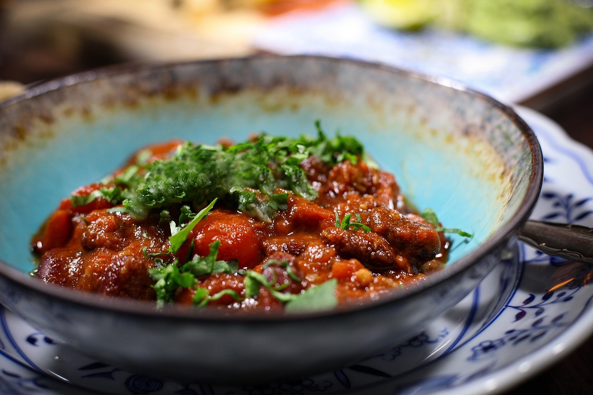 A bowl of taco mixture topped with coriander