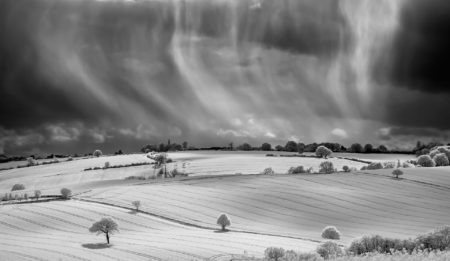 Raining over Fields of Rapeseed by James Woodend