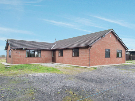 Detached four bedroomed bungalow, situated within a secluded farmland position.