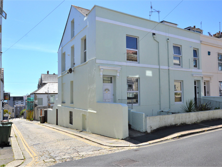 End terraced house divided into two maisonettes