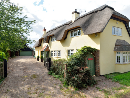 Substantial period home in village setting with picturesque gardens and natural swimming pool