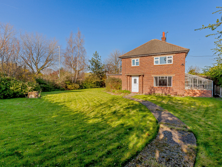 A detached property within large gardens with potential to extend