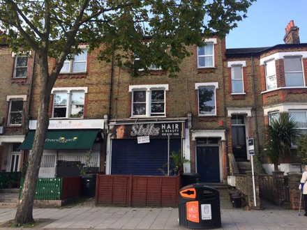 Freehold Investment Shop With 3 Flats Above Sold On Long Leases