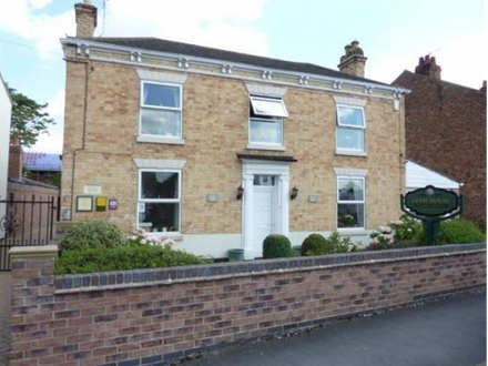 Seven Bedroom Detached House refurbished to a very high standard in 2014. Currently used as a Guest House but could be used as a large family home (subject to change of use)
