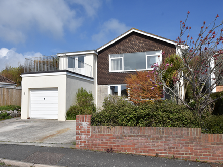 A detached four/five bedroom house with coastal and estuary views.