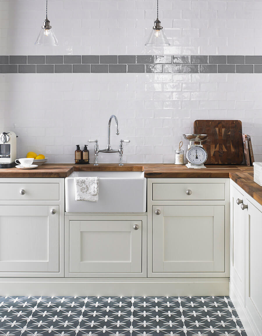 Laura Ashley Artisan Charcoal Wall tile LA51942 combined with Artisan Cobblestone Wall tile LA51539 shown with ivory kitchen and natural wood worktops