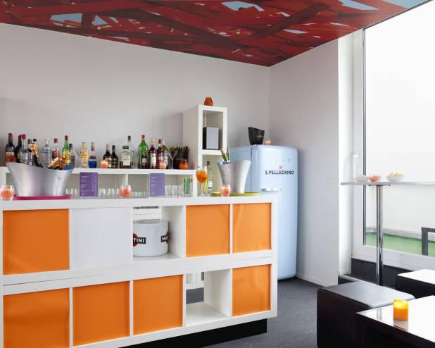 Splendid orange and red bar area in The Pantone Hotel