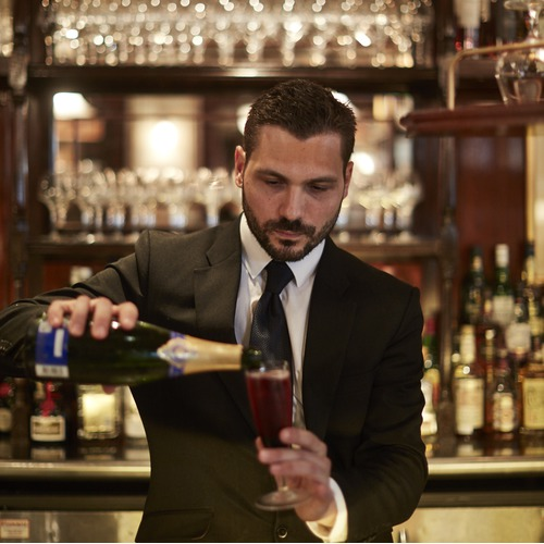Barman Pouring Champagne in Glass