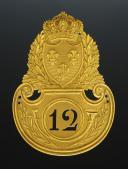 PLAQUE DE SHAKO D'OFFICIER DE VOLTIGEURS  DU 12ème RÉGIMENT D'INFANTERIE, modèle 1821, Restauration.
