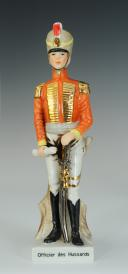OFFICIER DES HUSSARDS, FIGURINE EN PORCELAINE, XX°.