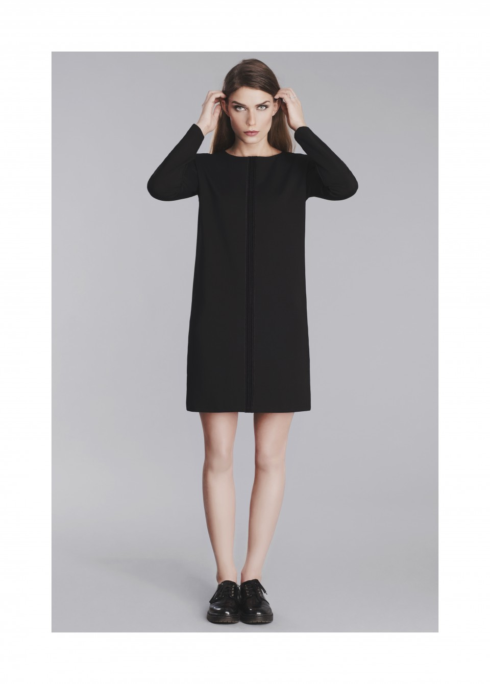 Straight black dress with decorative line application