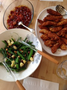 Olive oil poached tomatoes with crispy chicken fingers and green bean salad