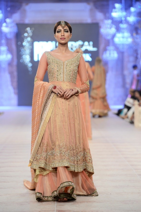A feminine and elegant peach bridal lehenga by Asifa and Nabeel