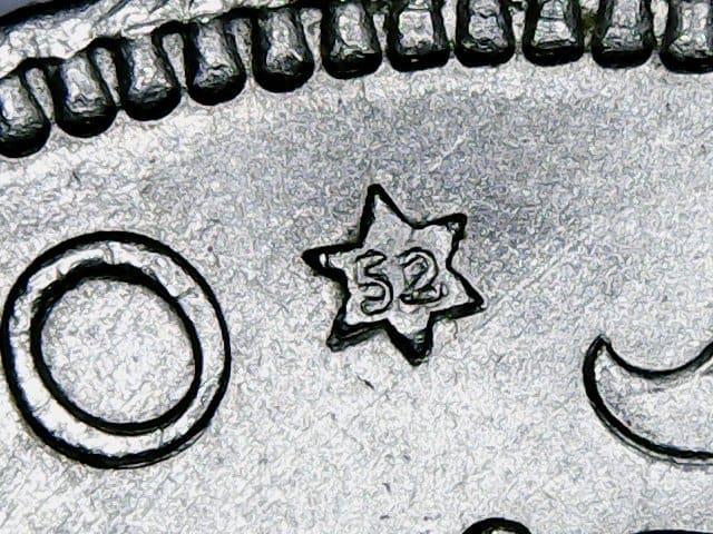 Estrellas troqueladas en las monedas de Franco