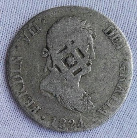 Coleccionar y tasar monedas con resellos
