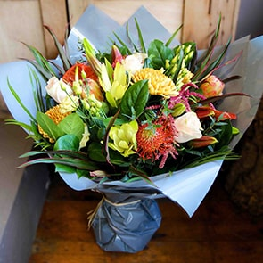 Artemis Flowers Delivered - This flower arrangement contains a combination of a gorgeous mix of warm autumn colours with an exotic twist. A striking and unusual bouquet, and would make a beautiful gift in the Autumn or winter months.