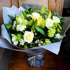 Athena Flowers Delivered - A classic combination of white and green seasonal flowers that gives off a country garden flower feel. Elegant and fresh, a perfect choice for any occasion.