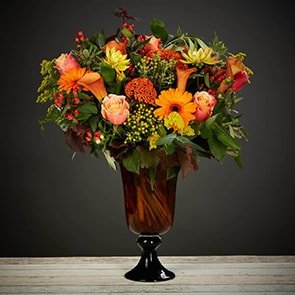 Autumn Leaves Flowers Delivered - A gorgeous mix of warm autumn colours. A striking and vibrant bouquet.
