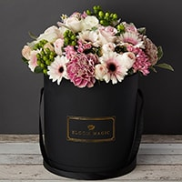Bloom Magic - Flower Delivery Ireland - This flower arrangement contains a winning combination of pink roses, and green gerbera, and it comes presented in your choice of pearl white or matte black hatbox. This bouquet is perfect for any room in your home, or for any occasion. You will receive a lot of compliments for this bouquet and it's available for delivery to Dublin, or anywhere in Ireland.