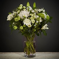 Bloom Magic - Flower Delivery Ireland - A classic combination of seasonal flowers containing white and green colours. This bouquet contains a variety of Elegant and fresh flowers. It comes as the perfect choice for any occasion; birthday flowers, Summer Flowers, or even engagement flowers. It is available for same day delivery in Dublin and next day delivery nationwide.