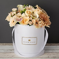 Bloom Magic - Flower Delivery Ireland - This bouquet screams white, and would brighten up any home or day. This arrangement comes in a pearl white, or matte black hatbox. It features white calla lilies, and white roses, that are hand tied by some of the country's top florists. Same day delivery is available in Dublin, and next day delivery is available to anywhere in Ireland.