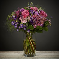 Bloom Magic - Flower Delivery United Kingdom - This bouquet of flowers combines muted mauves, vibrant purples and soft lilac shades inspire a real vintage feel. Featuring roses, veronica, september flowers and bunches of hydrangea, this bouquet is perfect for any occasion. The Classic Mauves is available for next day flower delivery all across the UK.