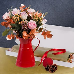 Comet Flowers Delivered - A bouquet dedicated to Comet's unique personality & charm ! Pale pink & lilac roses, peach hypercium & copper euco, complemented perfectly with pink wax flowers.