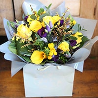 Bloom Magic - Flower Delivery Ireland - This bouquet offers sunny yellow and rich purple flowers that make it a particularly expresiive summer flower arrangement. The Gaia bouquet is lively and happy and sure to delivery a smile. Next day delivery Ireland is available.