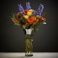Bloom Magic - Flower Delivery Ireland - A striking mix of bright yellow, burned orange and deep blue shades make this our most vibrant bouquet. Perfect for that happy occasion or to put a big smile back on someone's face. A perfect gift for an engagement, birthday flowers or a thank-you gift. This boquet is available for next-day delivery all across Ireland and same day flower delivery in Dublin.