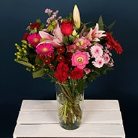 One of our most luxurious and impressive bouquets for blowing the socks off your loved one! This bouquet is an artfully created florist's choice for the season. Featuring pinks, reds and whites, this artisan bouquet will brighten their day and create a memory to last a lifetime. 
