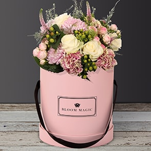 Jardins Du Luxembourg Flowers Delivered - Sitting in the Jardins du Luxembourg sipping your morning Café...Ah, life in Paris is grand! With this lovely Parisian hatbox you can enjoy a moment of happy bliss of your very own. The hues of this bouquet are like the reflections on the pond right in the middle of Jardins du Luxembourg. Featuring soft pinks and creamy whites, mixed with fresh greenery, this bouquet is sure to please for any occasion. Jardins du Luxembourg is available in a blush pink, charcoal gray or a powder blue hatbox. 
