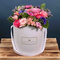 A wonderful arrangement of hatbox flowers, featuring spray roses and gerbera. This bouquet will wow you Mum this Mother's Day.