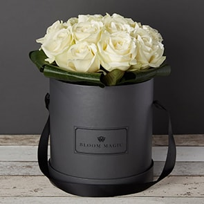 La Nuit Blanche Flowers Delivered - Beautiful seleciton of top quality white roses that comes in a charcoal grey or powder blue hat box. This is a beautiully luxurious flower arrangement that would make a perfect gift for any loved one.