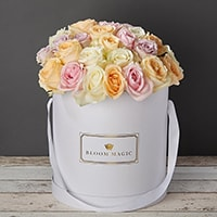 Bloom Magic - Flower Delivery Ireland - This arrangement contains a mix of some of the highest quality roses you can find anywhere in Ireland. The flowers are handtied and beautifully presented in a matte black and pearl white hat box. These roses are the perfect gift for any romantic occasion, whether it is wedding flowers, valentines flowers, or even birthday flowers. The person who opens their door when the flowers are delivered will be delighted with this beautifully presented gift.
