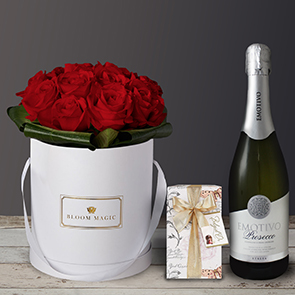 Mon Amour Gift Set Flowers Delivered - What could be more romantic than an elegant hatbox of Grade A Dutch red roses? The Mon Amour is one of our signature romantic hatboxes. This luxury arrangement will amaze your loved one and will create a memory to last a lifetime.