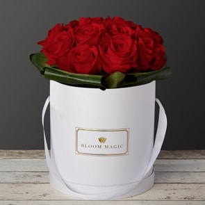"Mon Amour Flowers Delivered - What could be more romantic than an elegant hatbox of red roses? The ""Mon Amour""  is one of our signature hatboxes. This luxury hatbox of Grade A roses will amaze your loved one and will create a memory to last a lifetime"
