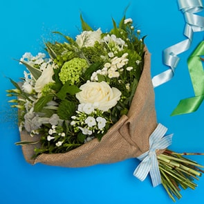 North Beach Beauty Flowers Delivered - Simplicity is pure and gorgeous. This bouquet features white roses and the freshest seasonal white blooms available. Artfully hand-tied with luxurious greenery, this bouquet is perfect for any occasion. 